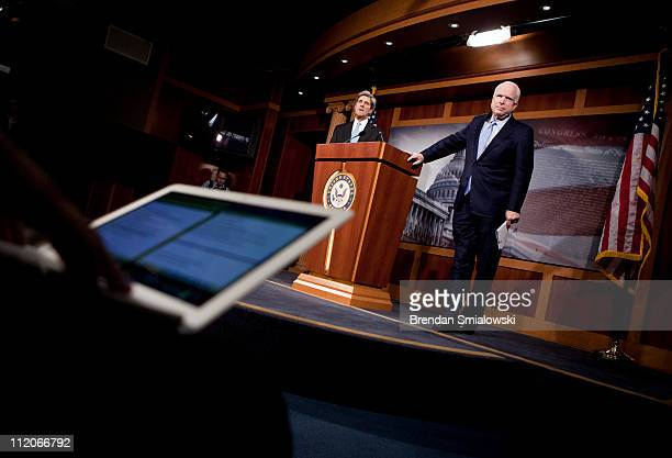 S Sen John McCain and US Sen John Kerry listen to a question during a press conference about consumer privacy on Capitol Hill April 12 2011 in...