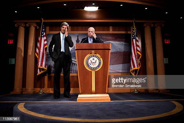 S Sen John McCain and US Sen John Kerry stand during a press conference during a press conference about consumer privacy on Capitol Hill April 12...