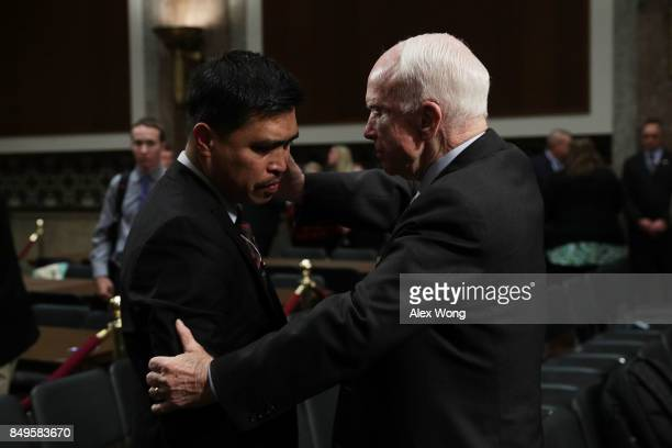 S Sen John McCain comforts father Victor Sibayan of Fire Controlman 2nd Class Carlos Sibayan who was killed on USS Fitzgerald after a hearing before...