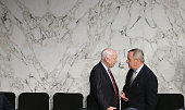 Sen John McCain confers with Sen Richard Durbin before US Secretary of State John Kerry US Defense Secretary Chuck Hagel and US Chairman of the Joint...