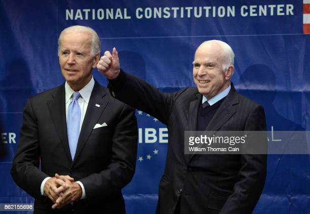 Sen John McCain give a thumbs up before receiving the the 2017 Liberty Medal from former Vice President Joe Biden at the National Constitution Center...
