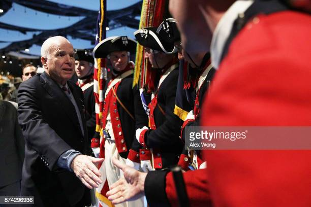 S Sen John McCain greets Army color guards after he was presented with the Outstanding Civilian Service Medal during a special Twilight Tattoo...