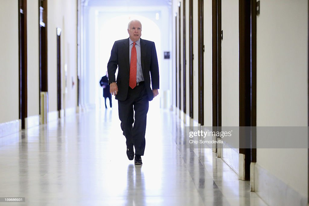 Sen. <a gi-track='captionPersonalityLinkClicked' href=/galleries/search?phrase=John+McCain&family=editorial&specificpeople=125177 ng-click='$event.stopPropagation()'>John McCain</a> (R-AZ) heads to his Russell Senate Office Building office before meeting with former U.S. Senator Chuck Hagel on Capitol Hill January 22, 2013 in Washington, DC. Hagel, who cochaired McCain's 2000 presidential campaign, has been nominated by U.S. President Barack Obama to succeed Leon Panetta as Secretary of Defense.