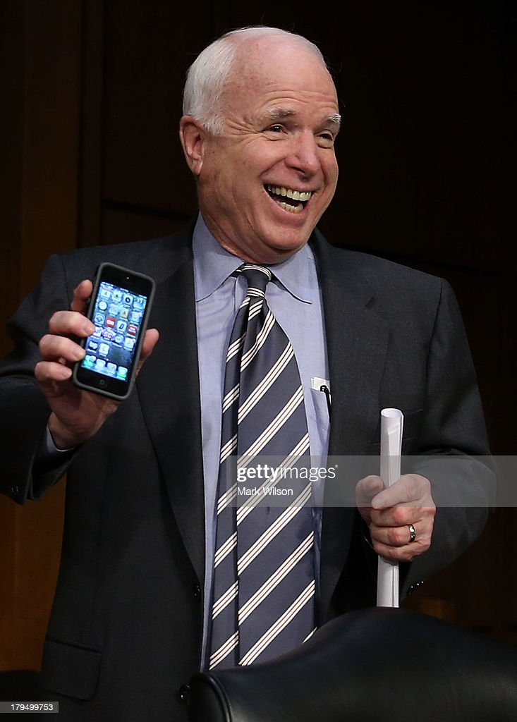 U.S. Sen. <a gi-track='captionPersonalityLinkClicked' href=/galleries/search?phrase=John+McCain&family=editorial&specificpeople=125177 ng-click='$event.stopPropagation()'>John McCain</a> (R-AZ) holds up his smart phone to show he is not playing poker before the Senate Foreign Relations Committee vote on a resolution on Syria on Capitol Hill September 4, 2013 in Washington, DC. The Senate Foreign Relations Committee voted to authorize U.S. President Barack Obama to use limited force against Syria after adopting amendments from U.S. Sen. <a gi-track='captionPersonalityLinkClicked' href=/galleries/search?phrase=John+McCain&family=editorial&specificpeople=125177 ng-click='$event.stopPropagation()'>John McCain</a> (R-NV).