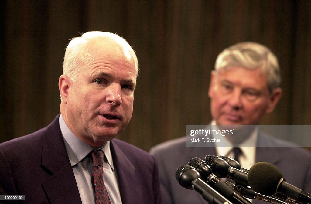 Sen. John Mccain (R-AZ), left, speaks out at a press conference on drug trafficking and economic stability in South America while Sen. Bob Graham (D-FL), right, listens to McCain.