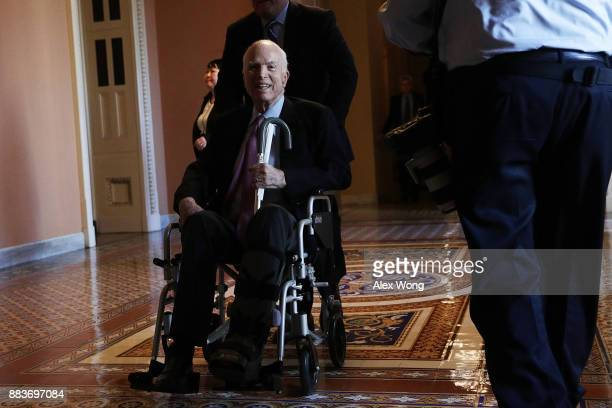 S Sen John McCain passes by on a wheelchair in a hallway at the Capitol December 1 2017 in Washington DC Senate GOPs indicate that they have enough...
