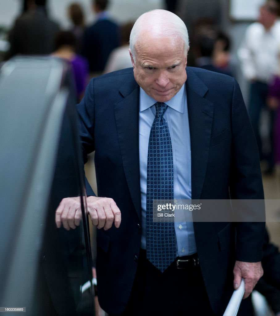Sen. John McCain, R-Ariz., arrives in the Capitol for the Senate policy lunches on Tuesday, Jan. 29, 2013.