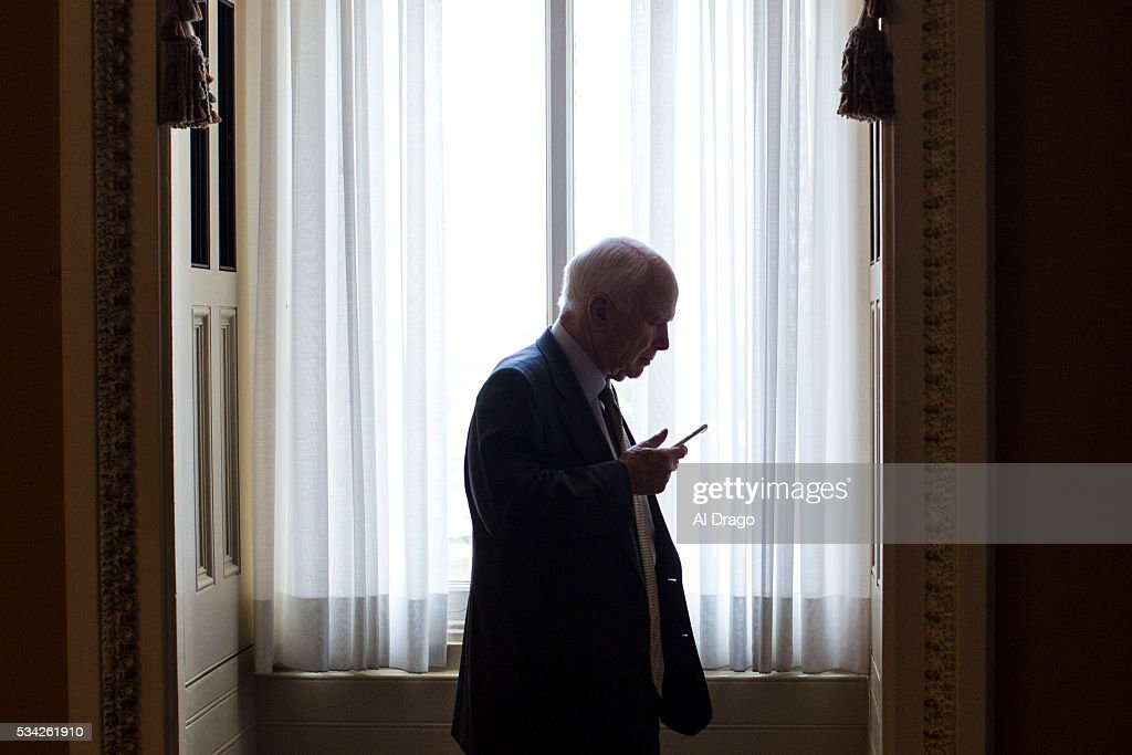 STATES - MAY 25 - Sen. John McCain, R-Ariz., speaks on the phone as he steps off the senate floor on Capitol Hill in Washington, Wednesday, May 25, 2016.