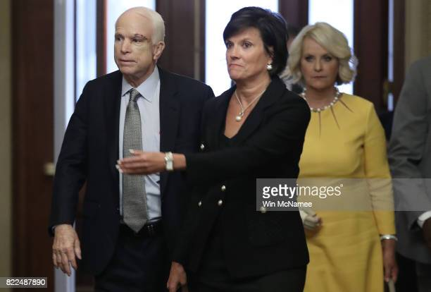 Sen John McCain returns to the US Senate accompanied by his wife Cindy July 25 2017 in Washington DC McCain was recently diagnosed with brain cancer...