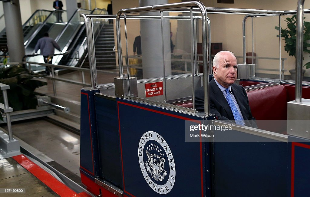 U.S. Sen. John McCain (R-AZ) rides on the Senate subway after participating in a news conference with people who have disabilities on Capitol Hill, December 3, 2012 in Washington, DC. Sen. McCain joined Senate Foreign Relations Chairman John Kerry (D-MA) as he urged fellow Senators to approve the 'Convention on the Rights of Persons with Disabilities bill, an international agreement for protecting the rights of individuals with disabilities.