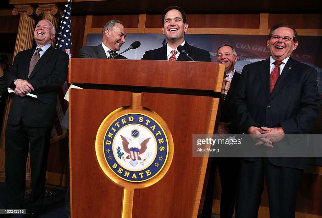U.S. Sen. <a gi-track='captionPersonalityLinkClicked' href=/galleries/search?phrase=John+McCain&family=editorial&specificpeople=125177 ng-click='$event.stopPropagation()'>John McCain</a> (R-AZ), Sen. <a gi-track='captionPersonalityLinkClicked' href=/galleries/search?phrase=Charles+Schumer&family=editorial&specificpeople=171249 ng-click='$event.stopPropagation()'>Charles Schumer</a> (D-NY), Sen. Marco Rubio (R-FL), Senate Majority Whip Sen. Richard Durbin (D-IL), and Sen. <a gi-track='captionPersonalityLinkClicked' href=/galleries/search?phrase=Robert+Menendez&family=editorial&specificpeople=504931 ng-click='$event.stopPropagation()'>Robert Menendez</a> (D-NJ) share a moment during a news conference on a comprehensive immigration reform framework January 28, 2013 on Capitol Hill in Washington, DC. A group of bipartisan senate members have reached to a deal of outlines to reform the national immigration laws that will provide a pathway for the 11 million illegal immigrants in the country to citizenship.
