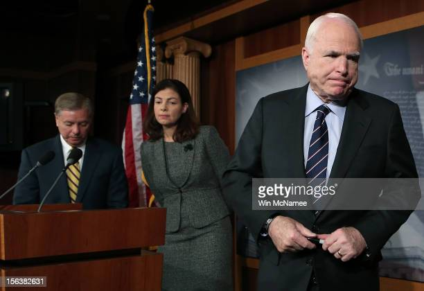 S Sen John McCain Sen Lindsey Graham and Sen Kelly Ayotte depart a news conference on the Benghazi terrorist attack at the US Capitol November 14...