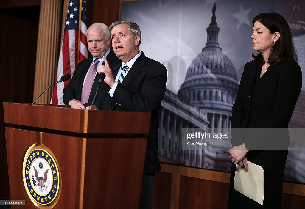 U.S. Sen. <a gi-track='captionPersonalityLinkClicked' href=/galleries/search?phrase=John+McCain&family=editorial&specificpeople=125177 ng-click='$event.stopPropagation()'>John McCain</a> (R-AZ) (L), Sen. <a gi-track='captionPersonalityLinkClicked' href=/galleries/search?phrase=Lindsey+Graham&family=editorial&specificpeople=240214 ng-click='$event.stopPropagation()'>Lindsey Graham</a> (R-SC) (C) and Sen. <a gi-track='captionPersonalityLinkClicked' href=/galleries/search?phrase=Kelly+Ayotte&family=editorial&specificpeople=6986995 ng-click='$event.stopPropagation()'>Kelly Ayotte</a> (R-NH) (R) speak to the press during a news conference on the terror attack that killed four Americans in Benghazi February 14, 2013 on Capitol Hill in Washington, DC. The senators questioned why the Obama Administration did not seek enough help from the Libya government during the attack.