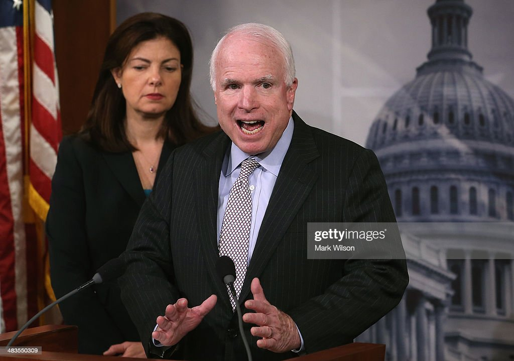 S Sen John McCain speaks about Benghazi while flanked by US Sen Kelly Ayotte during a news conference on Capitol Hill April 9 2014 in Washington DC...