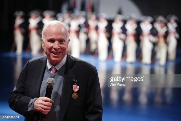 S Sen John McCain speaks after he was presented with the Outstanding Civilian Service Medal during a special Twilight Tattoo performance November 14...