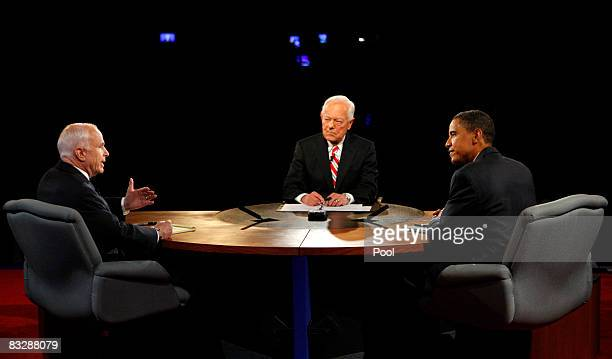 S Sen John McCain speaks as Democratic presidential candidate US Sen Barack Obama and moderator Bob Schieffer of CBS News listen during the third...