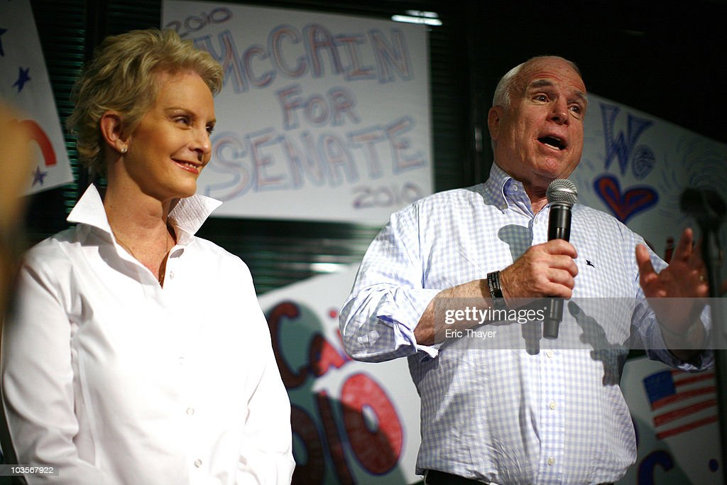 S Sen John McCain speaks as his wife Cindy listens during a visit to a campaign office one day before Arizona's primary election August 23 2010 in...