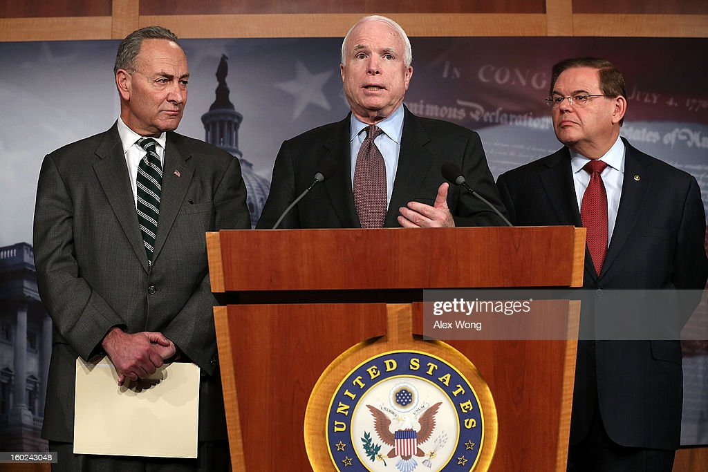 U.S. Sen. <a gi-track='captionPersonalityLinkClicked' href=/galleries/search?phrase=John+McCain&family=editorial&specificpeople=125177 ng-click='$event.stopPropagation()'>John McCain</a> (R-AZ) (C) speaks as Sen. <a gi-track='captionPersonalityLinkClicked' href=/galleries/search?phrase=Charles+Schumer&family=editorial&specificpeople=171249 ng-click='$event.stopPropagation()'>Charles Schumer</a> (D-NY) (L) and Sen. <a gi-track='captionPersonalityLinkClicked' href=/galleries/search?phrase=Robert+Menendez&family=editorial&specificpeople=504931 ng-click='$event.stopPropagation()'>Robert Menendez</a> (D-NJ) (R) listen during a news conference on a comprehensive immigration reform framework January 28, 2013 on Capitol Hill in Washington, DC. A group of bipartisan senate members have reached to a deal of outlines to reform the nation immigration laws that will provide a pathway for the 11 million illegal immigrants in the country to citizenship.