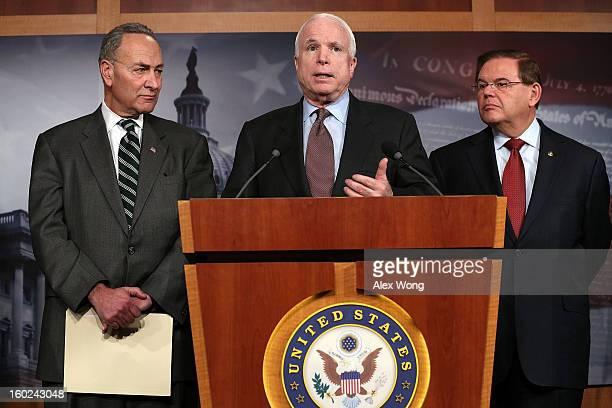 S Sen John McCain speaks as Sen Charles Schumer and Sen Robert Menendez listen during a news conference on a comprehensive immigration reform...