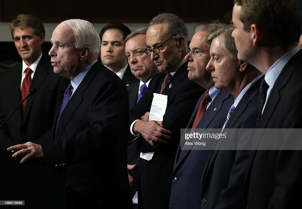 U.S. Sen. John McCain (R-AZ) (2nd L) speaks as (L-R) Sen. Jeff Flake (R-AZ), Sen. Marco Rubio (R-FL), Sen. Richard Durbin (D-IL), Sen. Chuck Schumer (D-NY), Sen. Bob Menendez (D-NJ), Sen. Lindsey Graham (R-SC), and Sen. Michael Bennet (D-CO) listen during a news conference on immigration reform April 18, 2013 on Capitol Hill in Washington, DC. The senators discussed on the 'Border Security, Economic Opportunity, and Immigration Modernization Act' that have been released on Wednesday.