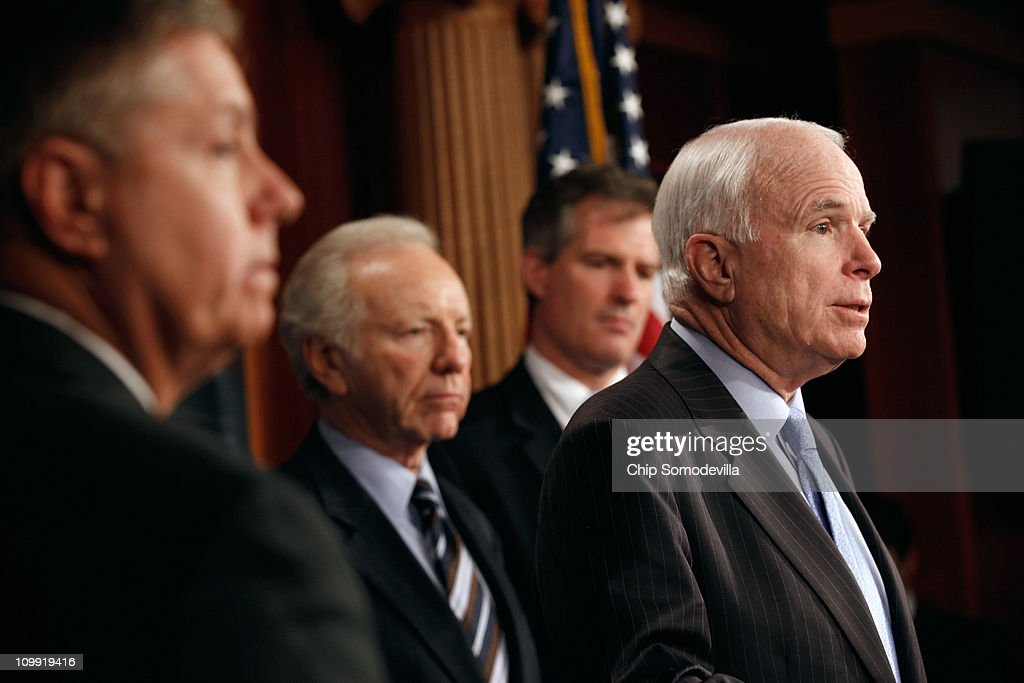 Sen. <a gi-track='captionPersonalityLinkClicked' href=/galleries/search?phrase=John+McCain&family=editorial&specificpeople=125177 ng-click='$event.stopPropagation()'>John McCain</a> (R-AZ) (R) speaks during a news conference with fellow senators (L-R) Sen. <a gi-track='captionPersonalityLinkClicked' href=/galleries/search?phrase=Lindsey+Graham&family=editorial&specificpeople=240214 ng-click='$event.stopPropagation()'>Lindsey Graham</a> (R-SC), Sen. Joe Lieberman (I-CT) and Sen. Scott Brown (R-MA) at the U.S. Capitol March 10, 2011 in Washington, DC. In the same week that President Barack Obama issued an executive order resuming military commissions for terrorists at Guantanamo Bay, Graham and other senators introduced military detainee legislation including the 'Military Detainee Procedures Improvement Act of 2011.'