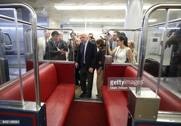 Sen John McCain speaks to reporters in the Senate Subway before the Senate takes up the National Defense Authorization Act for FY2018 on Capitol Hill...