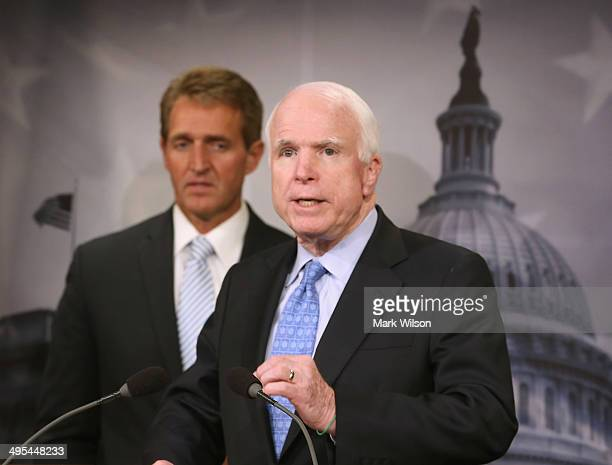 Sen John McCain speaks while flanked by Sen Jeff Flake during a news conference on veterans affairs on Capitol Hill June 3 2014 in Washington DC The...