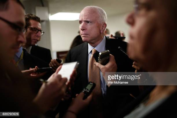 Sen John McCain speaks with reporters on the resignation of National Security Advisor Michael Flynn at the US Capitol on February 14 2017 in...