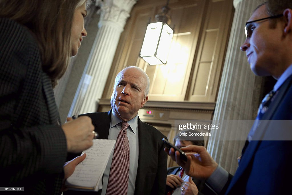 Sen. <a gi-track='captionPersonalityLinkClicked' href=/galleries/search?phrase=John+McCain&family=editorial&specificpeople=125177 ng-click='$event.stopPropagation()'>John McCain</a> (R-AZ) (C) talks with reporters before heading into the Senate chamber to vote against cloture on the confirmation of former Sen. Chuck Hagel (R-NE) to be the next Secretary of State at the U.S. Capitol February 14, 2013 in Washington, DC. Senators voted 58-40 against ending debate on the confirmation of Hagel, stalling his approval for another day or possibly a week.