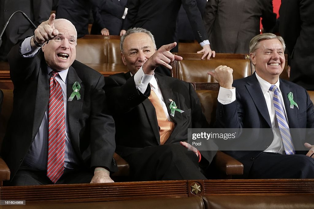 U.S. Sen. John McCain (R-AZ), U.S. Sen. Charles Schumer (D-NY, and U.S. Sen. Lindsey Graham (R-SC) sit on Capitol Hill on February 12, 2013 in Washington, D.C. Facing a divided Congress, Obama is expected to focus his speech on new initiatives designed to stimulate the U.S. economy.