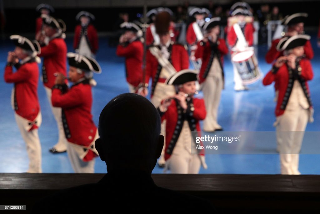 U.S. Sen. John McCain (R-AZ) watches a special Twilight Tattoo performance November 14, 2017 at Fort Myer in Arlington, Virginia. U.S. Sen. McCain was honored with the Outstanding Civilian Service Medal for over 63 years of dedicated service to the nation and the U.S. Navy.