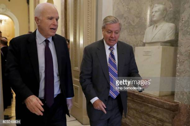 S Sen John McCain who was recently diagnosed with brain cancer and Sen Lindsey Graham head for the Senate Floor for a vote at the US Capitol July 26...
