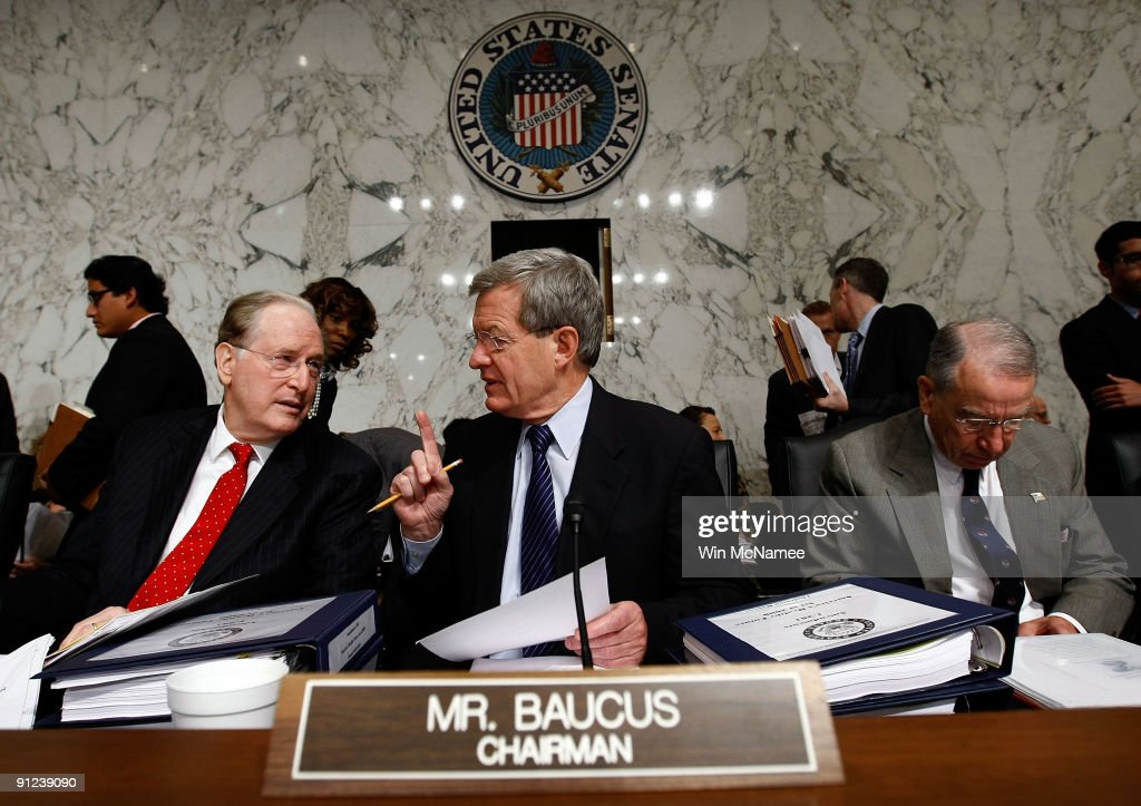 Sen. John Rockefeller (D-WV) talks with Committee Chairman Sen. <a gi-track='captionPersonalityLinkClicked' href=/galleries/search?phrase=Max+Baucus&family=editorial&specificpeople=242972 ng-click='$event.stopPropagation()'>Max Baucus</a> (D-MT) before the start of the full Senate Finance Committee markup of 'The America's Health Future Act' September 29, 2009 in Washington, DC. The committee is expected this week to tackle the issues of how to pay for the proposed health care plan and whether or not it should include a public insurance option with amendments offered by Sen. Rockefeller and Sen. Charles Schumer (D-NY). Also pictured at right is ranking member Sen. Charles Grassley (R-KS).