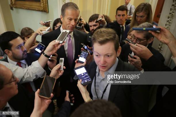 Sen John Thune is surrounded by reporters before heading into the Senate Republican policy luncheon at the US Capitol August 1 2017 in Washington DC...
