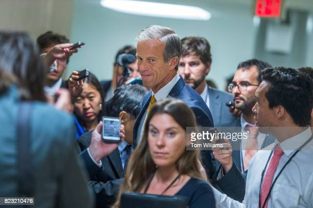 Sen John Thune RSD talks with reporters in the senate subway before a series of votes in the Capitol related to the healthcare plan on July 26 2017