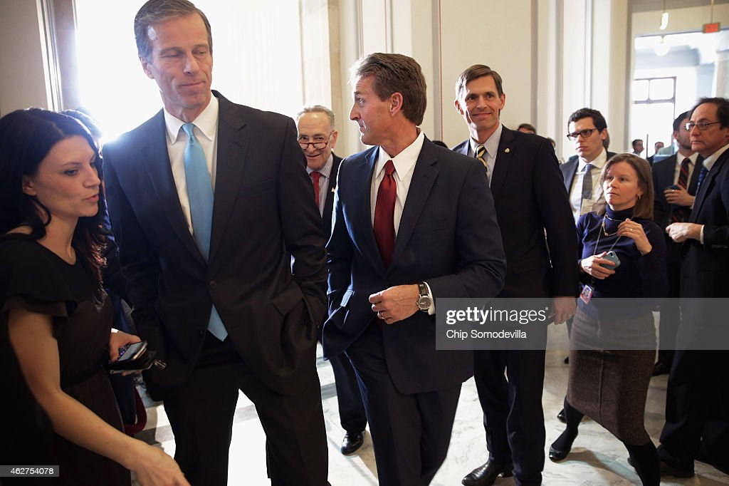 Sen. <a gi-track='captionPersonalityLinkClicked' href=/galleries/search?phrase=John+Thune&family=editorial&specificpeople=534356 ng-click='$event.stopPropagation()'>John Thune</a> (R-SD), Sen. <a gi-track='captionPersonalityLinkClicked' href=/galleries/search?phrase=Jeff+Flake&family=editorial&specificpeople=2474871 ng-click='$event.stopPropagation()'>Jeff Flake</a> (R-AZ), Sen. <a gi-track='captionPersonalityLinkClicked' href=/galleries/search?phrase=Martin+Heinrich&family=editorial&specificpeople=5592274 ng-click='$event.stopPropagation()'>Martin Heinrich</a> (D-NM) and Sen. <a gi-track='captionPersonalityLinkClicked' href=/galleries/search?phrase=Charles+Schumer&family=editorial&specificpeople=171249 ng-click='$event.stopPropagation()'>Charles Schumer</a> (D-NY) talk to reporters after a Senate bipartisan lunch in the Russell Senate Office Building on Capitol Hill February 4, 2015 in Washington, DC. The senators from both parties said they did not talk about current issues during the lunch and said they plan to continue the bipartisan lunch once every month.