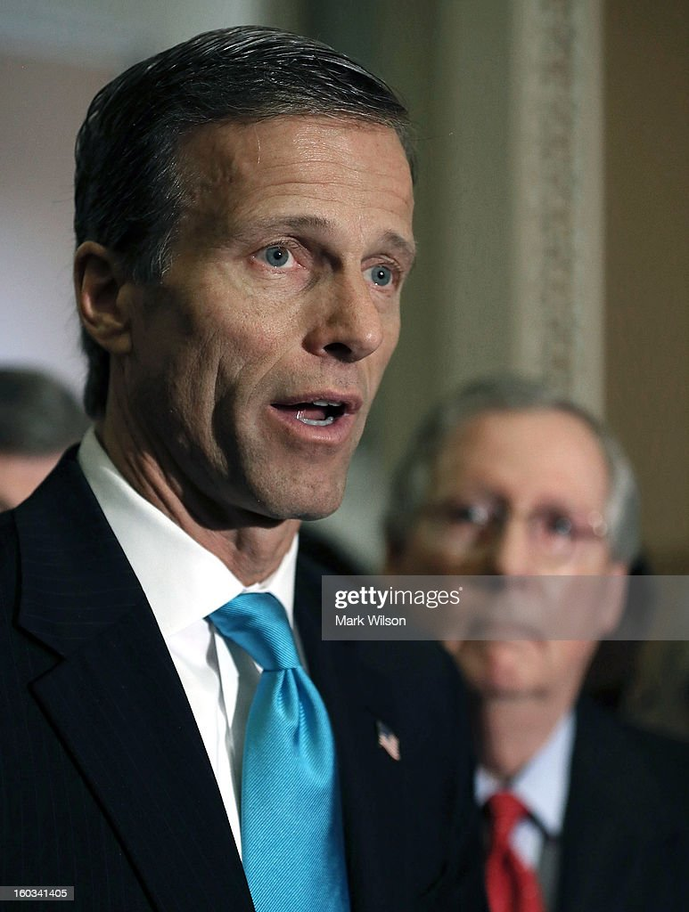 Sen. <a gi-track='captionPersonalityLinkClicked' href=/galleries/search?phrase=John+Thune&family=editorial&specificpeople=534356 ng-click='$event.stopPropagation()'>John Thune</a> (R-SD) (L) speaks to the media while flanked by Senate Minority Leader Sen. Mitch McConnell (R-KY) after the weekly Senate Republican policy luncheon at the U.S. Capitol January 29, 2013 in Washington, DC. Senate Republicans gathered at the luncheon to discuss their agenda.