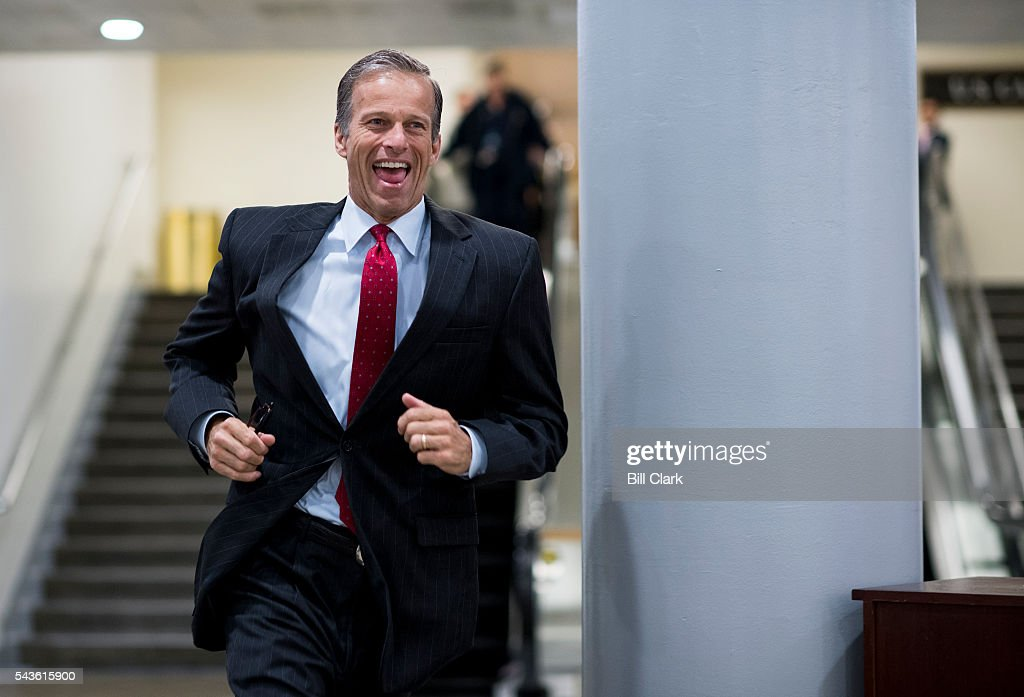 Sen. John Thune (R-SD) sprints to catch the Senate subway following a vote in the Capitol on Wednesday, June 29, 2016.