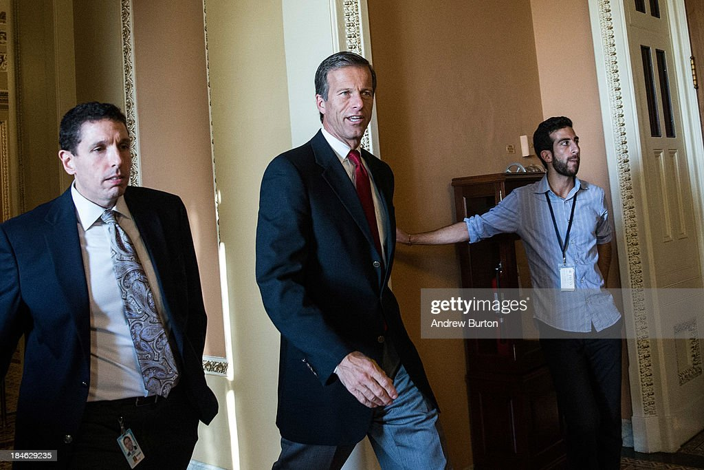 Sen. <a gi-track='captionPersonalityLinkClicked' href=/galleries/search?phrase=John+Thune&family=editorial&specificpeople=534356 ng-click='$event.stopPropagation()'>John Thune</a> (R-SD) (C) walks through the Capitol Building on October 14, 2013 in Washington, DC. As Democratic and Republican leaders negotiate an end to the shutdown and a way to raise the debt limit, the White House postponed a planned Monday afternoon meeting with Boehner and other Congressional leaders. The government shutdown is currently in its 14th day.