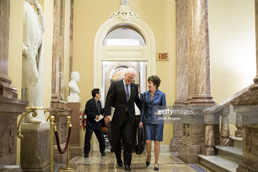 U.S. Sen. Jon Cornyn (R-TX) (L) and U.S. Sen. <a gi-track='captionPersonalityLinkClicked' href=/galleries/search?phrase=Susan+Collins&family=editorial&specificpeople=212962 ng-click='$event.stopPropagation()'>Susan Collins</a> (R-ME) talk on their way to a closed-door meeting with Senate Republicans on Capitol Hill on December 31, 2012 in Washington, DC. The House and Senate are both still in session on New Year's Eve to try to deal with the looming 'fiscal cliff' issue.