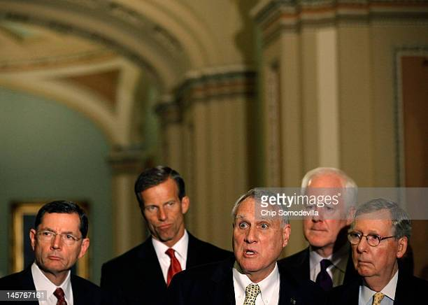 Sen Jon Kyl answers reporters' questions during a news conference with Sen John Barrasso Sen John Thune Sen John Cornyn and Senate Minority Leader...