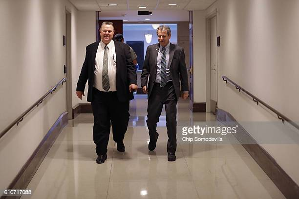 Sen Jon Tester and Sen Sherrod Brown leave a classified briefing they and other members of the Senate received about the investigation into suspected...