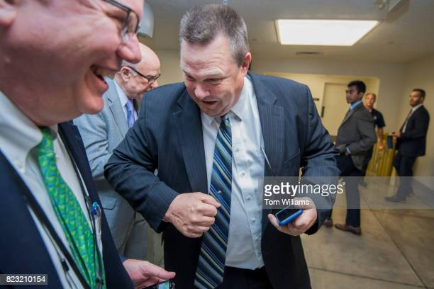 Sen Jon Tester DMont jokingly blocks a a reporter away from Sen Pat Roberts RKan in the senate subway before a series of votes in the Capitol related...