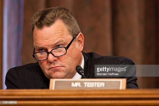 S Sen Jon Tester listens during a hearing on Capitol Hill October 13 2011 in Washington DC The Senate held a hearing to discuss the possibility of...