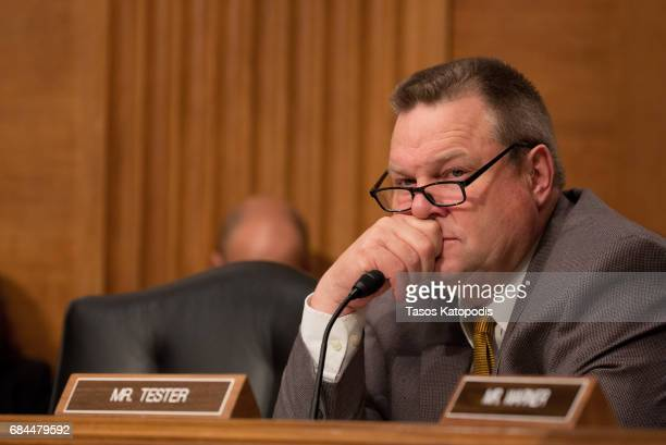 S Sen Jon Tester listens to Treasury Secretary Steven Mnuchin at a Senate Banking Committee and International Policy hearing on Capital Hill May 18...