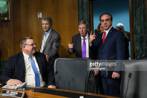 Sen Jon Tester Sen Sherrod Brown committee chairman Sen Johnny Isakson and David Shulkin President Donald Trump's nominee for Secretary of Veterans...