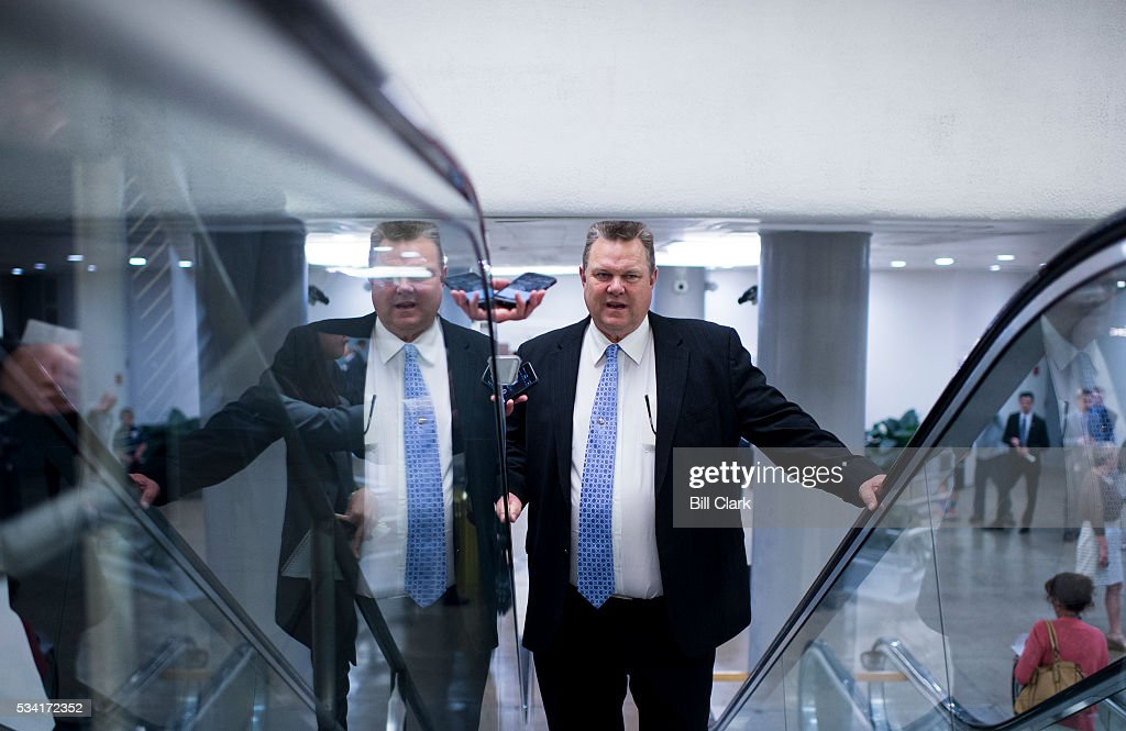 Sen. Jon Tester (D-MT) speaks with a reporter as he arrives for votes in the Capitol on Wednesday, May 25, 2016.