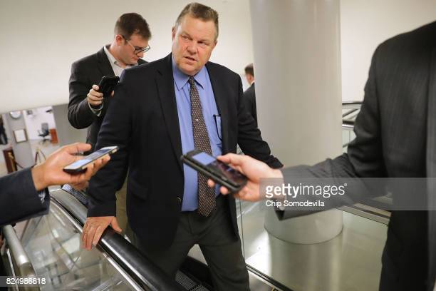 Sen Jon Tester talks to reporters as he heads to the US Capitol for a vote July 31 2017 in Washington DC Senate GOP leadership was unable to repeal...