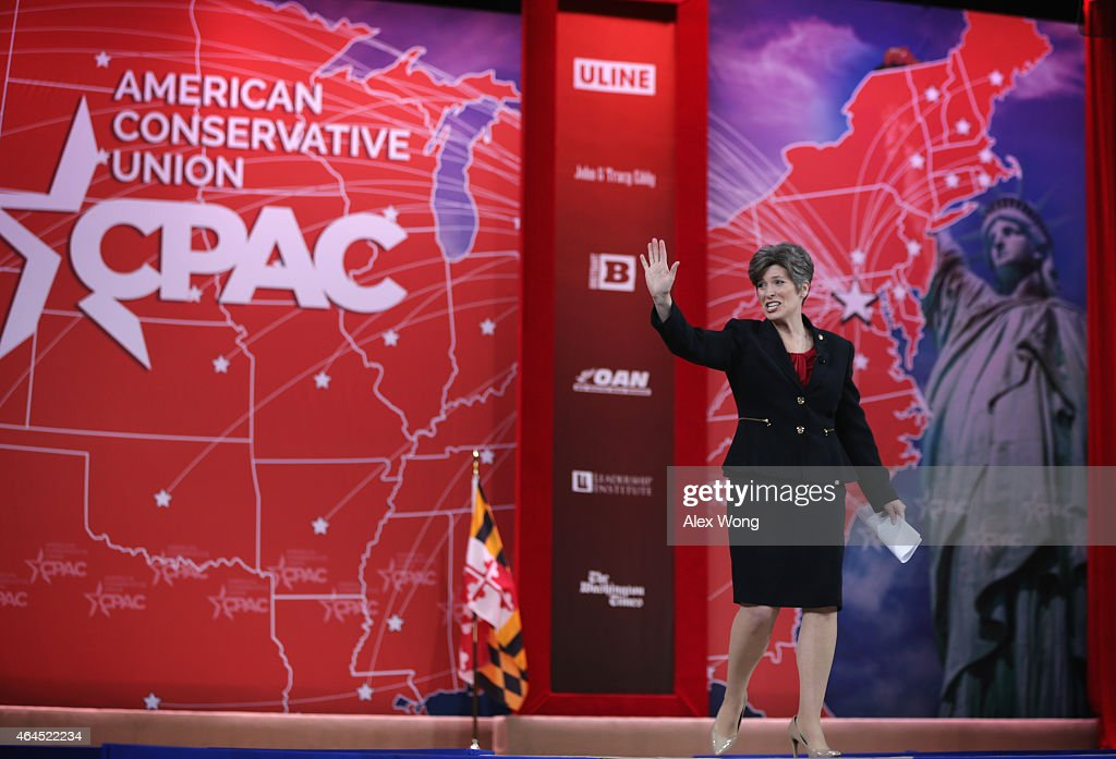 U.S. Sen. Joni Ernst (R-IA) waves as she approaches the podium to address the 42nd annual Conservative Political Action Conference (CPAC) February 26, 2015 in National Harbor, Maryland. Conservative activists attended the annual political conference to discuss their agenda.