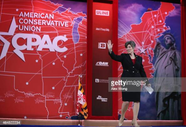 S Sen Joni Ernst waves as she approaches the podium to address the 42nd annual Conservative Political Action Conference February 26 2015 in National...